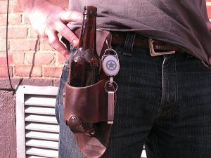 Attach the Holstar Logo Bottle Opener and Retractable Reel to your holstar using the small hole we place in the upper corner of your holstar. Open any beer any time and never lose your bottle opener again!